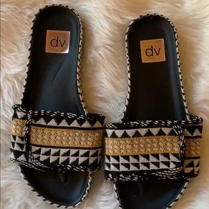 Dolce Vita black, white, and yellow woven slip ons